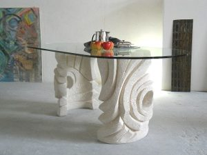 hand-carved stone and glass top dining table